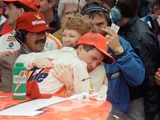Darrell Waltrip hugs his wife,  Stevie, in victory
