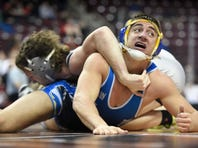Northern Lebanon's Luke Funck, shown wrestling Thursday against Brookville, had a pin Friday afternoon in the Vikings' 36-31 win over Southern Columbia.