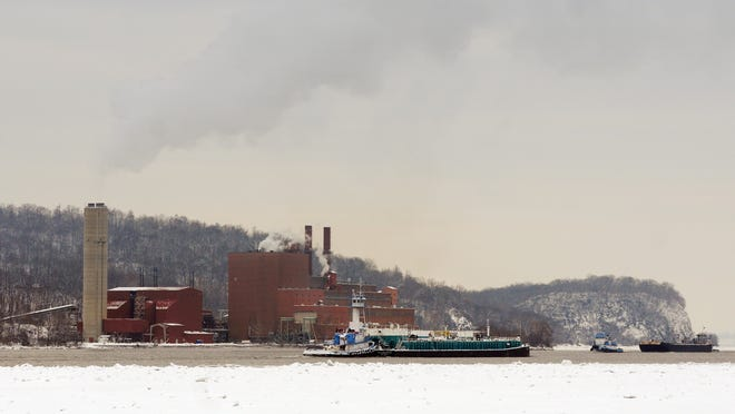 Two barges pass near the Danskammer Electric Generating Plant on the Hudson River in 2011 when it was in operation.