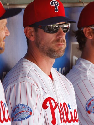 Phillies starting pitcher Cliff Lee sits in the dugout during a spring training baseball game March 3 against the New York Yankees at Bright House Field. Credit: Kim Klement-USA TODAY Sports
