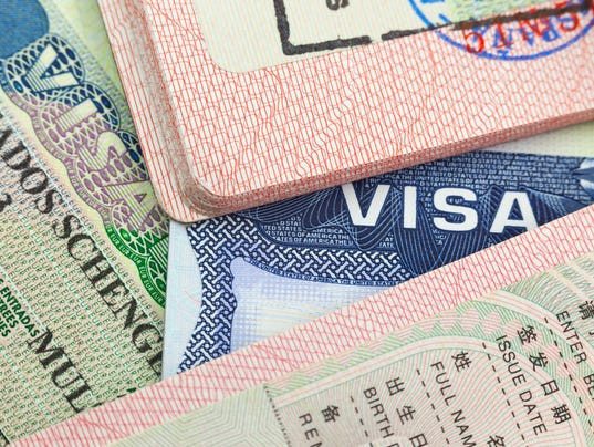 Chinese, USA and Shengen European visas in passports