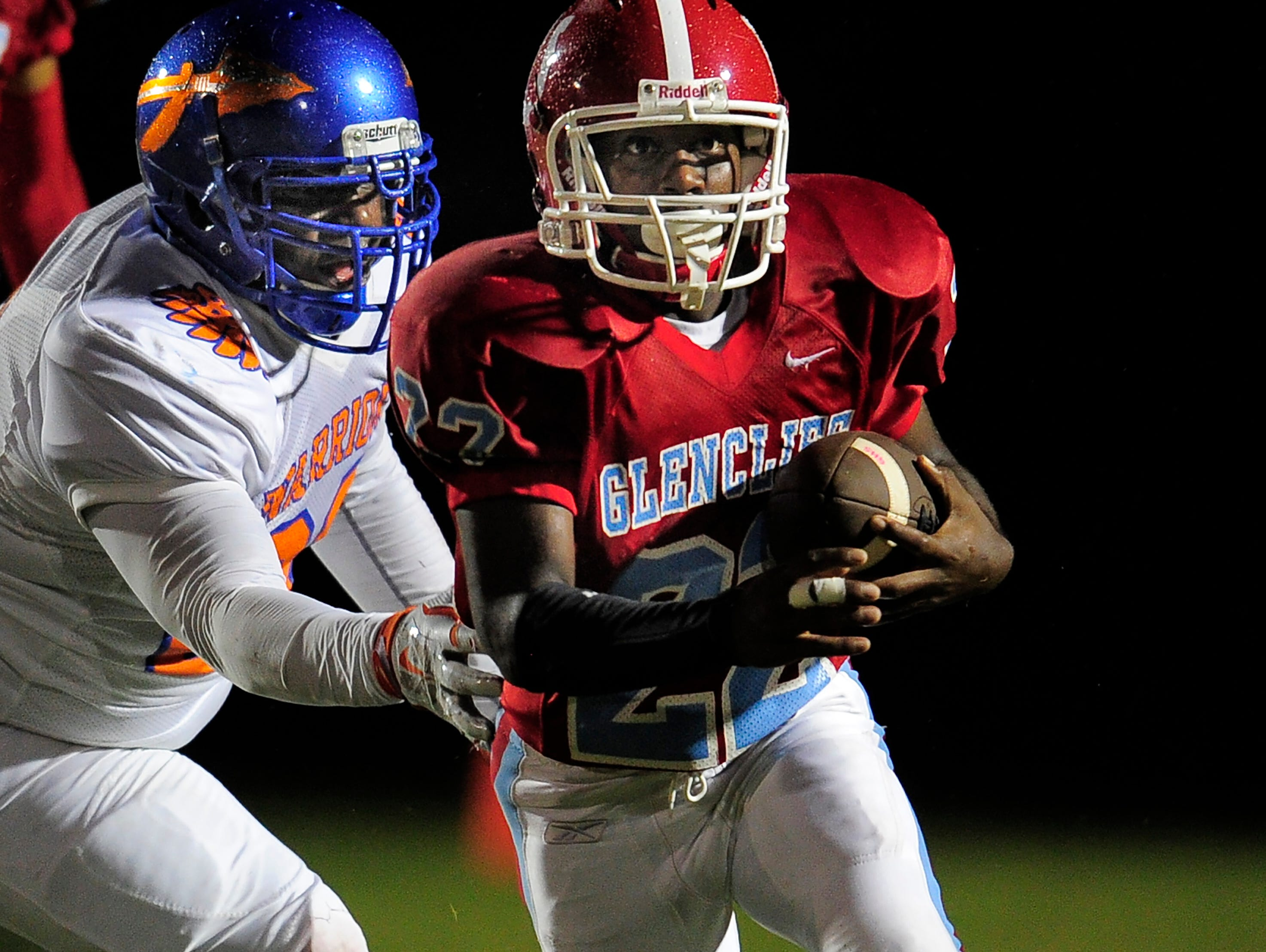 Glencliff running back Jonathan Jefferson (22) tries to get past a Hunters Lane defender during their game Friday.