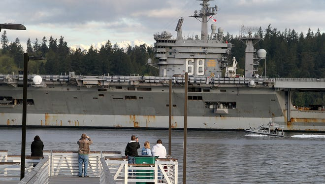 The USS Nimitz passes the Annapolis Pier in South Kitsap when it returned from a training mission on April 27. The aircraft carrier will deploy on Thursday, the Navy announced.