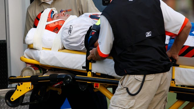 Ben Utecht is loaded into an ambulance after a hit during training camp in August of 2009.