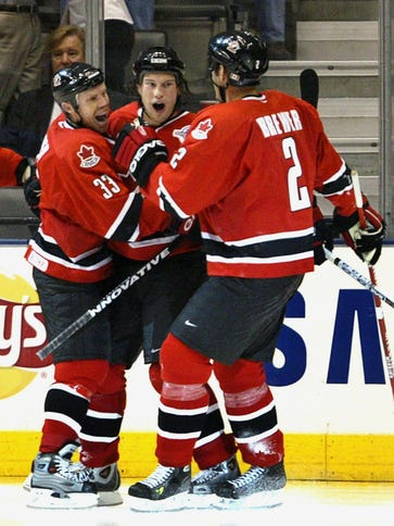 Team Canada players celebrate a Shane Doan goal in