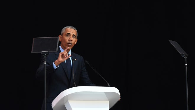 President Barack Obama speaks during the annual Mandela Lecture to commemorate Mandela Day, Johannesburg, South Africa, July 17 2018.