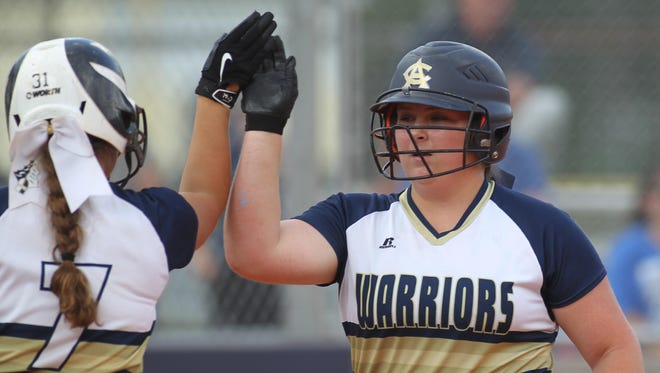 Aucilla Christian's Ashlyn Rogers high fives teammate Kelly Horne. The pair lead in batting average for the Warriors, who are chasing their third consecutive state championship.