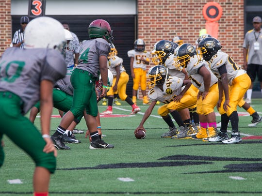 The Cincinnati Eagles and Columbus Eagles football teams play at the Sheakley Athletics Center. More than 40 teams of kids gathered for the 10th annual Peace Bowl Sunday July 31, 2016.