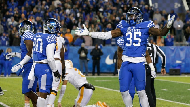 Kentucky defensive end Denzil Ware celebrates after sacking Tennessee quarterback Jarrett Guarantano in the final seconds of the second half of an NCAA college football game Saturday, Oct. 28, 2017, in Lexington, Ky. Kentucky won the game 29-26.