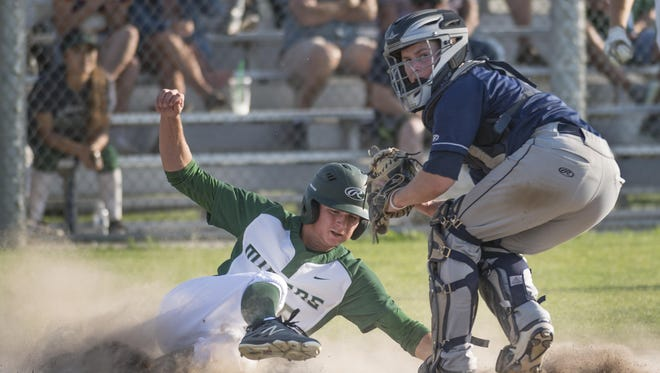 Redwood catcher Parker Cantrell spins to hold other runners after outing El Diamante's Drake Beno in a West Yosemite League baseball game on Wednesday, April 19, 2017.