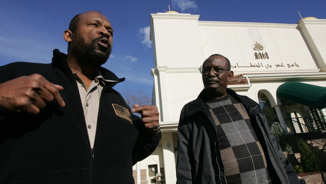 Badr Awad, left, and Mohamed Abdel Rahman are seen before going into their Paterson mosque in 2012.