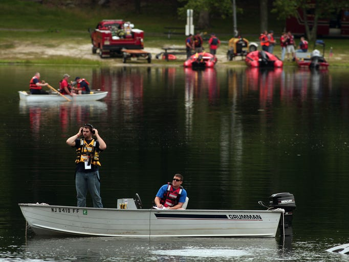 Search teams use side scan sonar as they conduct a massive water search for a 60-year-old man who was training for a triathlon and disappeared at Cook's Pond on Friday. July 19, 2014, Denville, NJ. Photo by Bob Karp