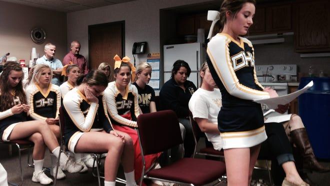 Maia Steigerwalt, co-captain of Delta High School's cheerleading team, addresses the school board on Oct. 20.