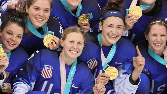 United States players celebrate their Olympic gold medal.