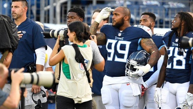 Titans defensive tackle Jurrell Casey (99) salutes during the National Anthem before the preseason game against the Tampa Bay Buccaneers at Nissan Stadium Saturday, Aug. 18, 2018, in Nashville, Tenn.