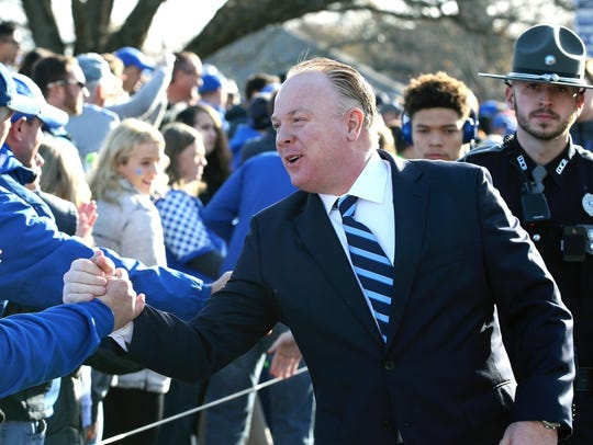 Kentucky coach Mark Stoops greets fans prior to his