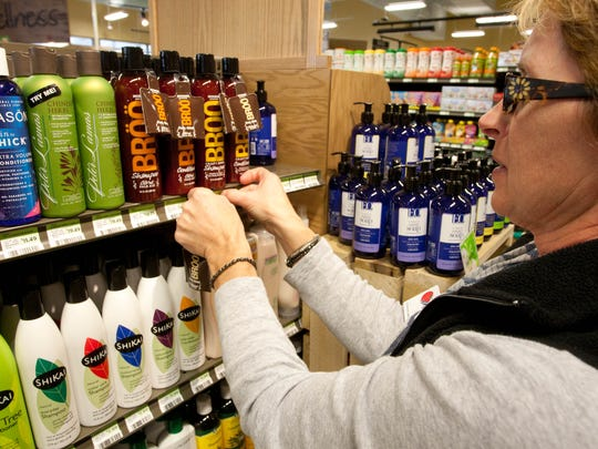 DeDe Coate stocks shampoo at Earth Fare, an upscale supermarket chain focused on natural and organic products, Noblesville, Nov. 6, 2012. Their first store in the state of Indiana opens in Hamilton Town Center, Nov. 7. (D. Kevin Elliott / For the Star)
