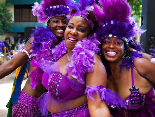 Caribbean dancers show off their lavish costumes at