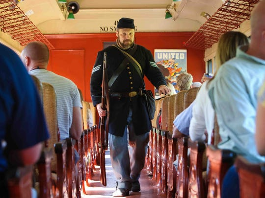 Sean Protas of Newport, historian with the 2nd Delaware Volunteer Infantry, walks down the isle of the train as  Wilmington & Western Railroad held their Civil War Skirmish Weekend Sunday, Sept. 14, 2014.  Riders travel with troops for over 2-hours for a round-trip train ride to the site of a skirmish between Union and Confederate forces where men and women dress in authentic period costumes using weapons of that time.