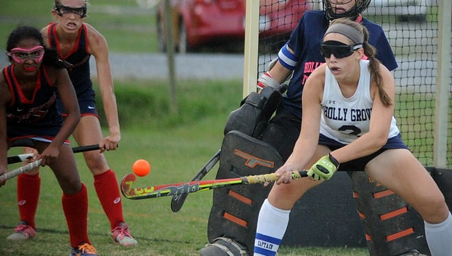 Holly Grove's Jerri Lankford (2) blocks a shot from Worcester Prep with her stick on Friday, Oct. 21, 2016, at the ESIAC championship field hockey game in Westover.