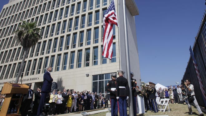 U.S. Secretary of State John Kerry watches the raising of the American flag at the newly opened U.S. Embassy in Havana, Cuba, Friday.