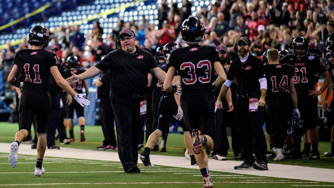 Seen here in the 2017 Class 2A state championship, Southridge coach Scott Buening (center) will begin his eighth season with the Raiders. Southridge won 9 games last year and advanced to the sectional championship game.