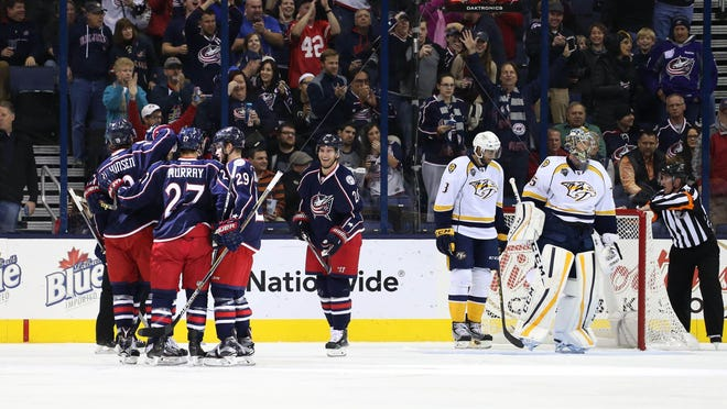 Blue Jackets players celebrate a goal by center Ryan Johansen (not pictured) in the first period Friday.