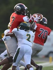 Mount Healthy's Brandon Lanier tries to bring in a