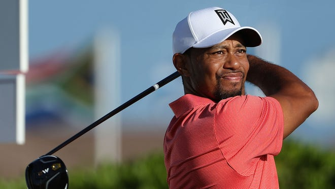 Tiger Woods tees off on the first hole at the pro-am Wednesday ahead of the Hero World Challenge in the Bahamas.