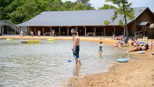 In this May 2014 file photo, families play in the lake at Shenandoah Acres