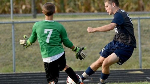 Granville's Ryan Birgeneau is challenged by Lakewood's goalie during their Licking County League match last week.
