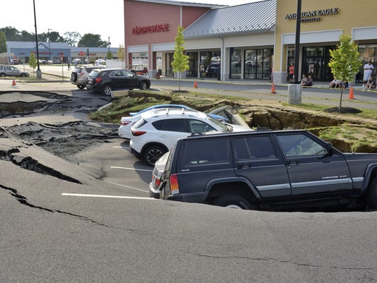 Mall Sinkhole Swallows Cars