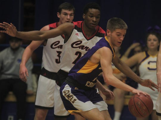 Campbell County senior Tanner Clos is guarded by Clark