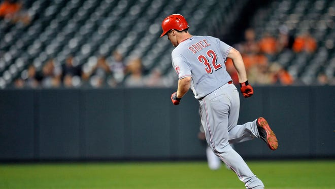Cincinnati Reds right fielder Jay Bruce (32) rounds second base after hitting a grand slam in the eighth inning against the Baltimore Orioles at Oriole Park at Camden Yards. The Orioles defeated the Reds 5-4.