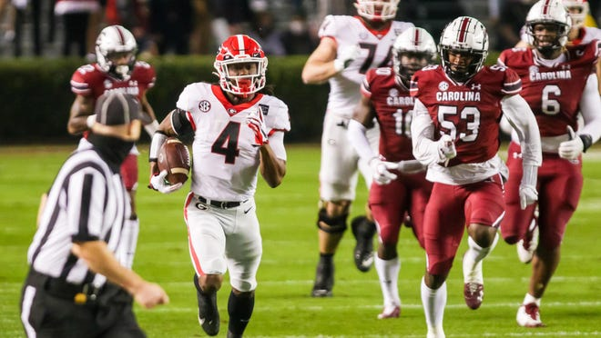 Nov 28, 2020; Columbia, South Carolina, USA; Georgia Bulldogs running back James Cook (4) rushes for a long gain against the South Carolina Gamecocks during the first quarter at Williams-Brice Stadium. Mandatory Credit: Jeff Blake-USA TODAY