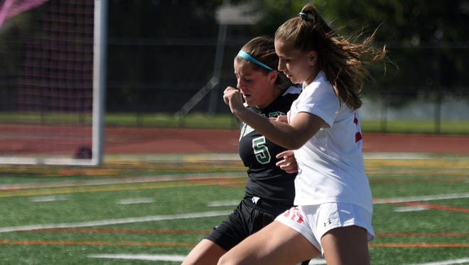 Cass McCabe (white) and Northern Highlands will host Lauren Hussey (5) and Pascack Valley in Monday's North 1, Group 3 girls soccer semifinal.