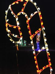 A closeup of a lighted candy cane at Winter WonderFest drive through light show at Cape Henlopen State Park.