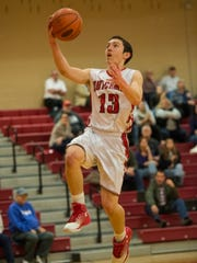 Annville-Cleona's Ryan Mathews drives to the hoop as