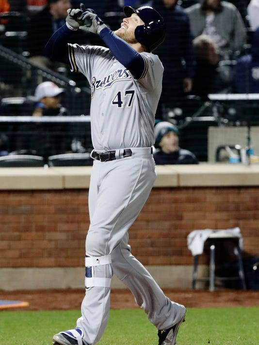 Milwaukee Brewers' Jett Bandy (47) celebrates after hitting a home run during the fourth inning of a baseball game against the New York Mets, Saturday, April 14, 2018, in New York. (AP Photo/Frank Franklin II)