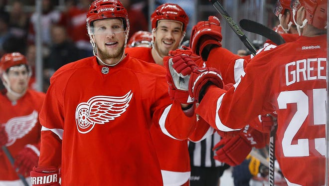 Red Wings left wing Justin Abdelkader celebrates his goal in the first period of the Wings' 5-4 win in a shoot-out Tuesday at Joe Louis Arena.