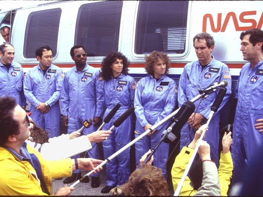 "Space shuttle Challenger crew. Francis ""Dick"" Scobee, Michael Smith, Judy Resnik, Christa McAuliffe, Ron McNair, Ellison Onizuka, Gregory Jarvis. FLORIDA TODAY file photo --1/86---Space shuttle Challenger crew meeting the media at the launch pad. Francis ""Dick"" Scobee; Michael Smith; Judy Resnik; Christa McAuliffe; Ron McNair; Ellison Onizuka; Gregory Jarvis"