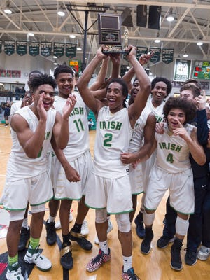 The Cathedral High School team celebrate their victory in the Indianapolis City Boy's Basketball Tournament championship game Monday, Jan. 23, 2017, at Arsenal Tech High School. Cathedral won 91-67.
