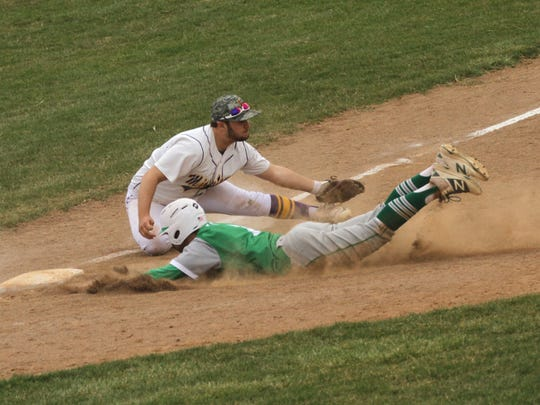 Clear Fork's Hunter Auck slides into third base against Lexington's Owen Murray on Saturday.