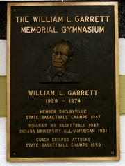 A plaque memorializing Bill Garrett hangs in the William