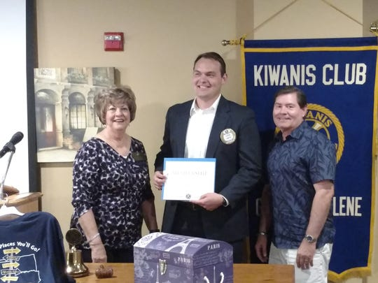 Gail Jay, president of the Kiwanis Club of Greater Abilene, welcomes new member Kevin Smith, with sponsor Vance Cooksey.