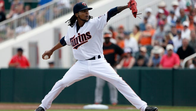 Minnesota Twins' Ervin Santana works against the Baltimore Orioles in the first inning of a spring training baseball game in Fort Myers on Sunday.
