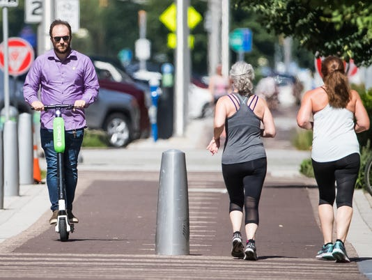 Lime scooters have joined Bird scooters on Indianapolis streets
