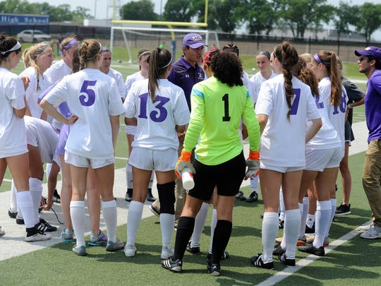 Wylie coach Manuel Cordova talks to his team before the Region I-4A semifinal against Fort Worth Castleberry at the Birdville ISD Fine Arts/Athletics Complex on April 13.