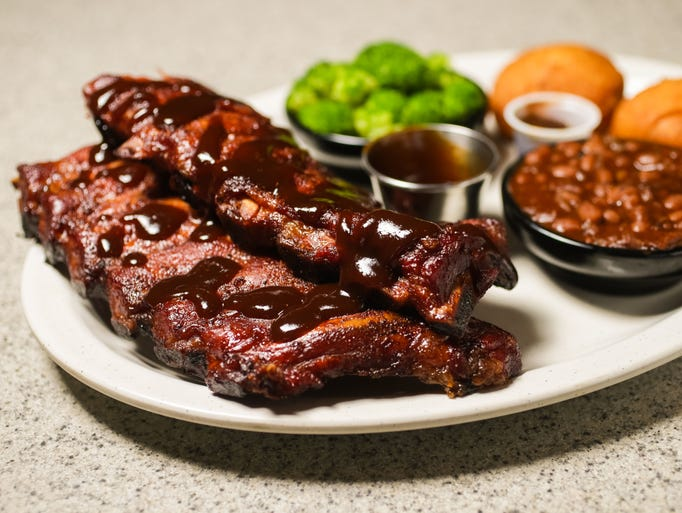 Award Winning Baby Back Ribs, half slab $16.59, whole slab $20.99, from Squealers Barbeque, 5515 W 86th St.