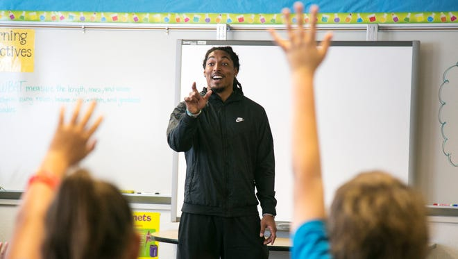 Carolina Panthers safety Tre Boston answers questions from fourth and fifth graders at Career Day on Friday at Patriot Elementary School in Cape Coral.